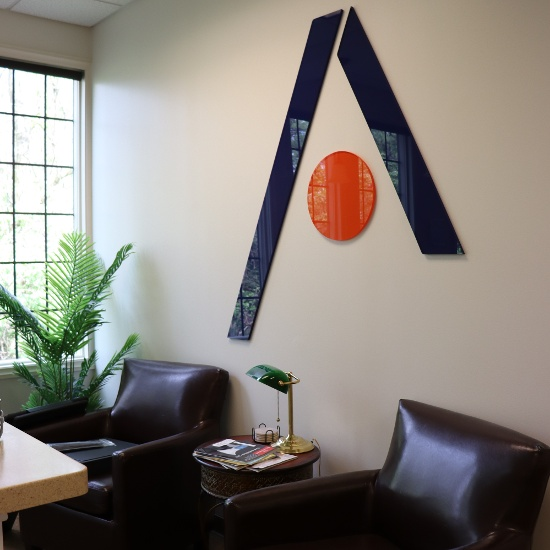 AdaptaLogix A-logo sign in the office