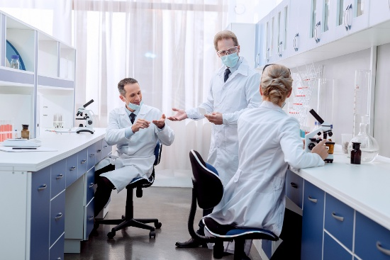 Pharmaceutical researchers discussing workflow improvement